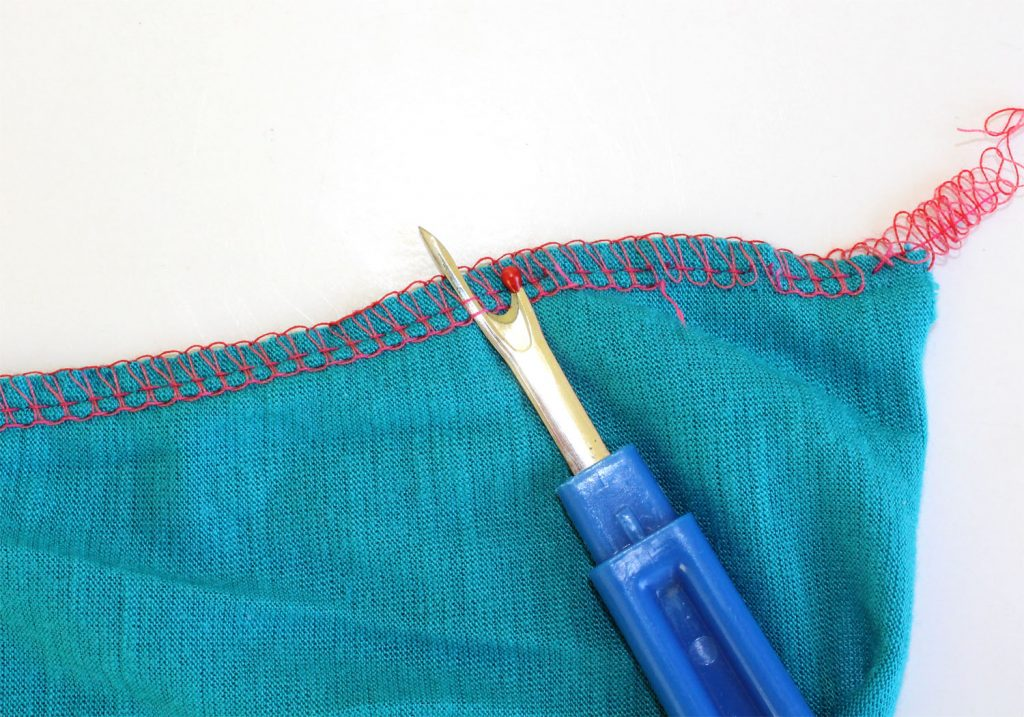Seam ripping a serged seam.